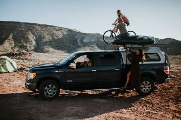 Ridding a bike on top of a moving truck